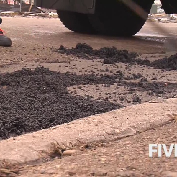 Crews rush to fix potholes damaged from Winter