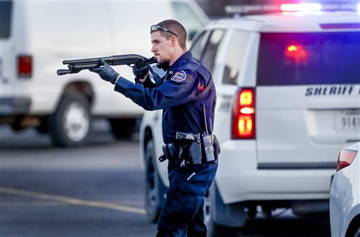 Shooting-Kansas Business_144892