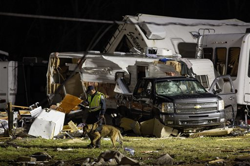 First responders search the remains of trailers and vehicles after a suspected tornado hit the Sugar Hill RV Park in Convent, La., Tuesday, Feb. 23, 2016. St. James Parish Sheriff Willy Martin says authorities are using dogs to search piles of...