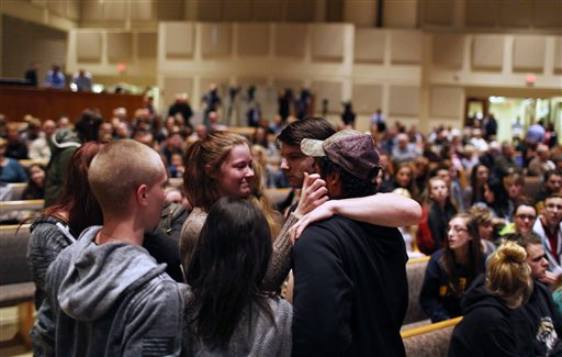 Members of the community pray before the start of the Kalamazoo Community Prayer Service at Centerpoint Church on in Kalamazoo, Mich., Sunday, Feb 21, 2016. A gunman who seemed to choose his victims at random opened fire Saturday outside an...
