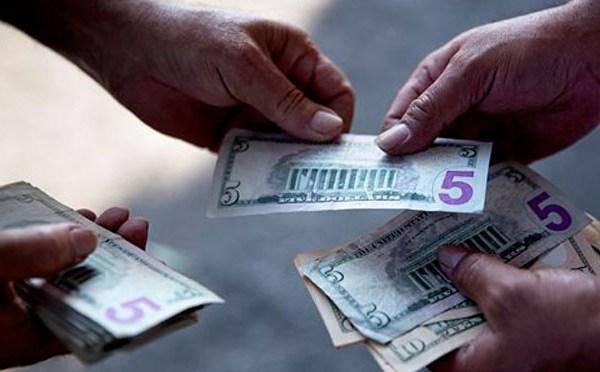 handing cash money_105946