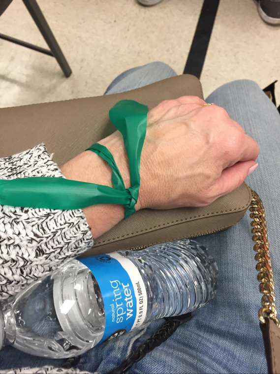 Passengers of Amtrak train that derailed in Gray County receive green wrist band to indicate they are not injured. (Photo: Courtesy Sally Canning)