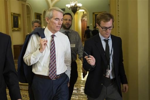Sen. Rob Portman, R-Ohio, talks to reporters on Capitol Hill, Monday, June 20, 2016, in Washington. A divided Senate hurtled Monday toward an election-year stalemate over curbing guns, eight days after Orlando's mass shooting horror intensified...
