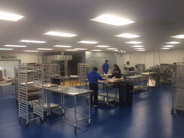 Workers inside Lindy's bake and package 10 types of dog treats. (Photo by: WDTN/Jake Ryle)