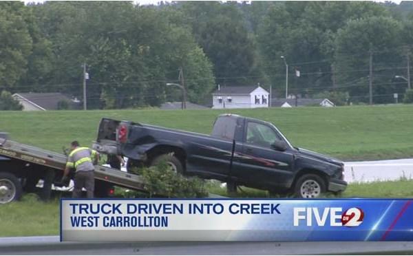 truck in creek_256492