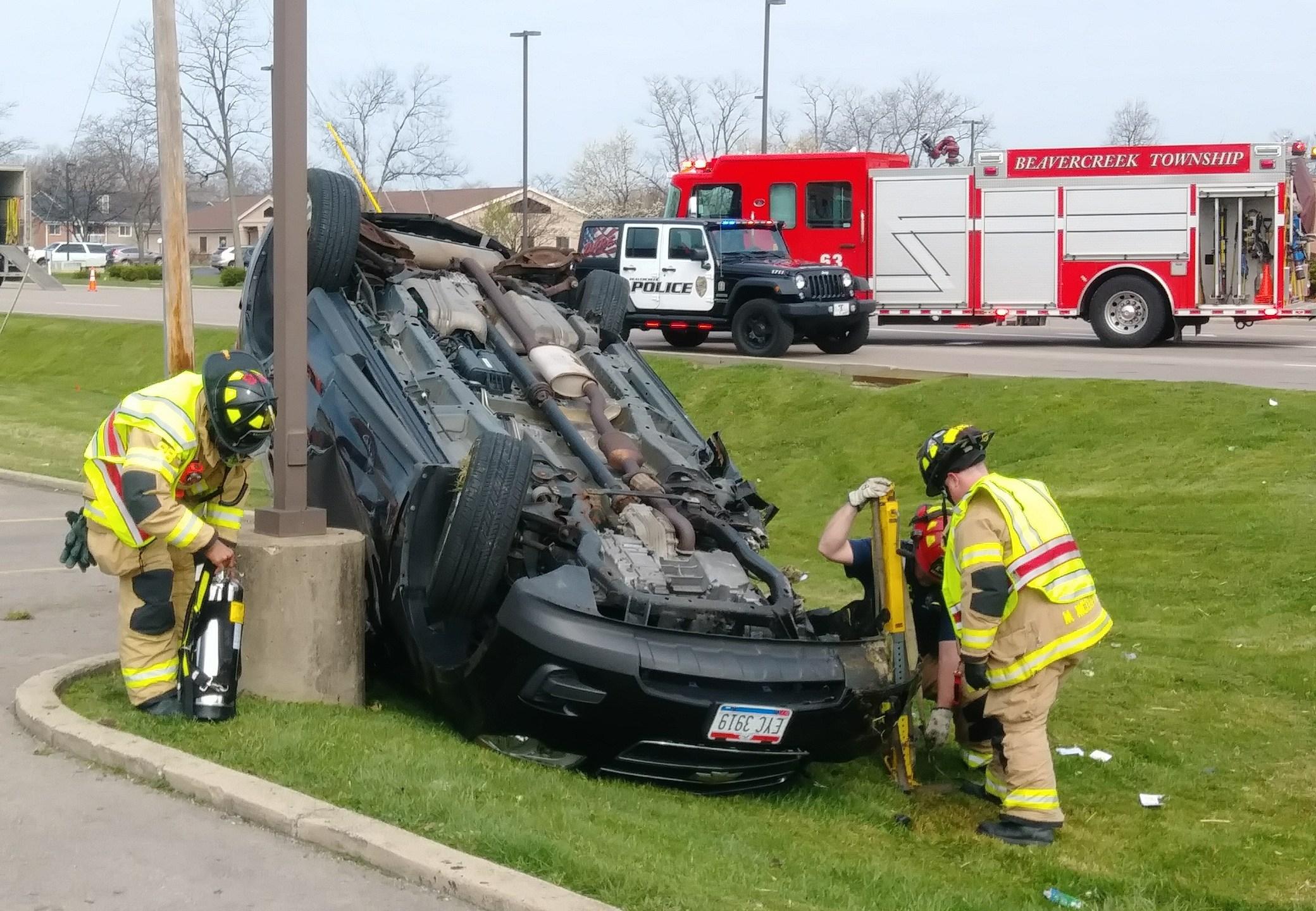 Car flips over in three-vehicle crash in Beavercreek