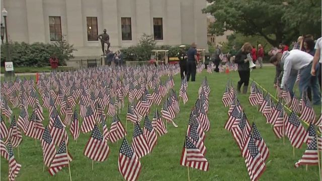 Volunteers place flags at Ohio Statehouse in memory of those who died on 9/11