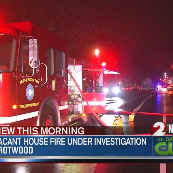 Passerby spots smoke in vacant house fire