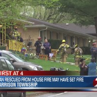 Man rescued from house fire may have set fire