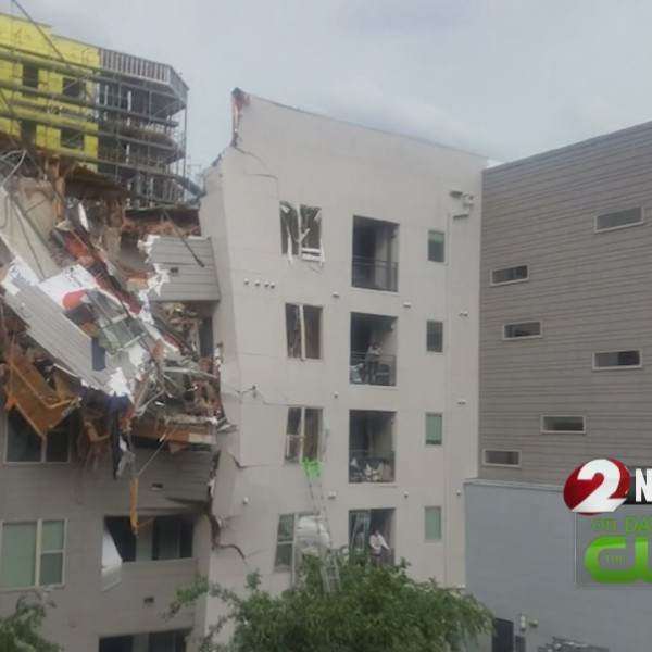 1 killed when crane topples on Dallas apartments