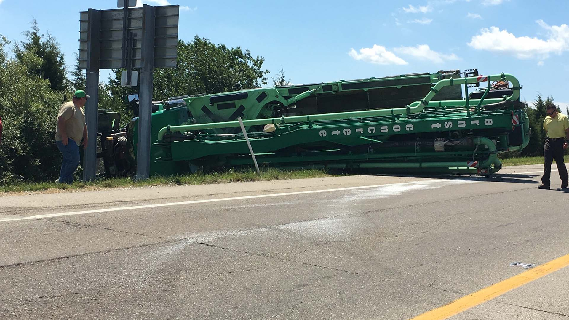 Concrete truck tips over