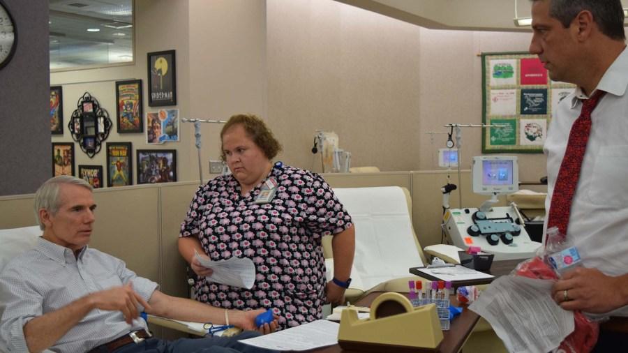 Portman donating blood