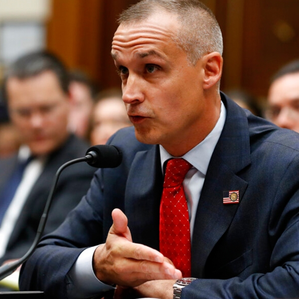 Corey Lewandowski, former campaign manager for President Donald Trump, references a copy of the Mueller Report that he requested to be brought to him, as he testifies to the House Judiciary Committee Tuesday, Sept. 17, 2019, in Washington. (AP Photo/Jacquelyn Martin)
