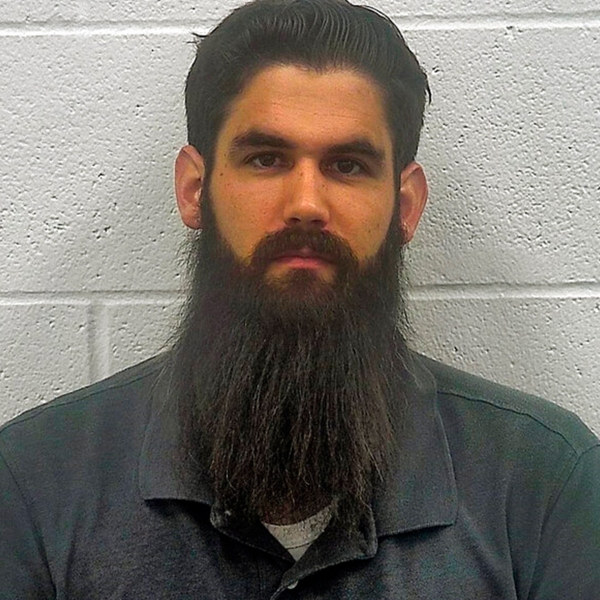 """This Sunday, Sept. 15, 2019 booking photo from the Kenton County (Kentucky) Police Department shows Daniel Kibler. Kibler, of Kentucky, accused of threatening to blow up a Planned Parenthood facility in Cincinnati was ordered held on $100,000 bond Monday, Sept. 16 after police found a """"homemade destructive device"""" at his home. WXIX-TV reports Kibler was arrested Sunday after police searched his home in Independence. He is charged with possession of a destructive device, terroristic threatening and eight counts of wanton endangerment. (Kenton County Police Department via AP)"""