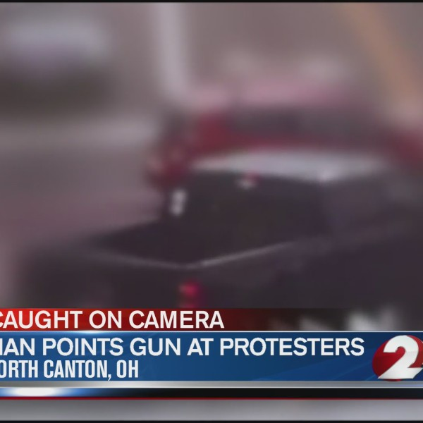 Man points gun at protesters