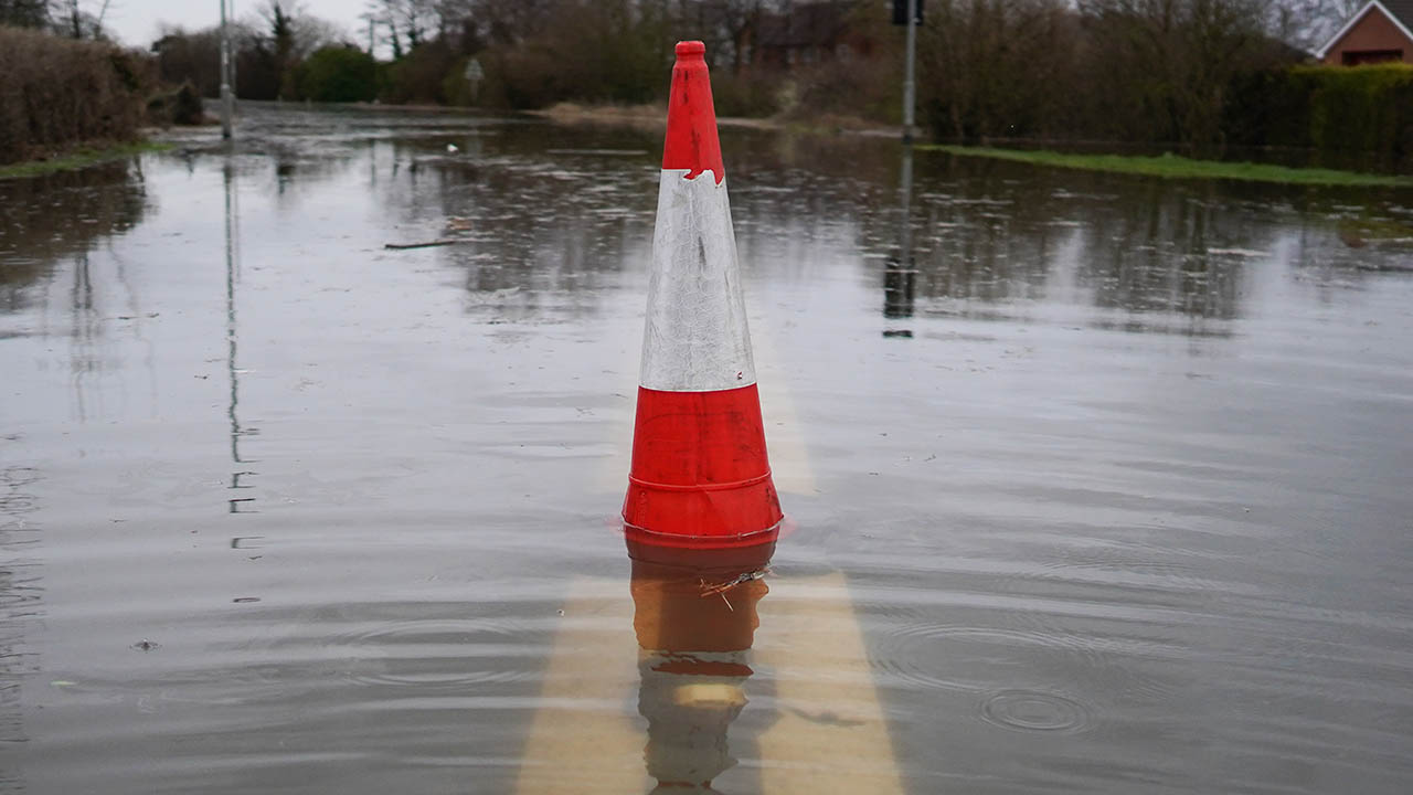 Traffic Cone in water on street