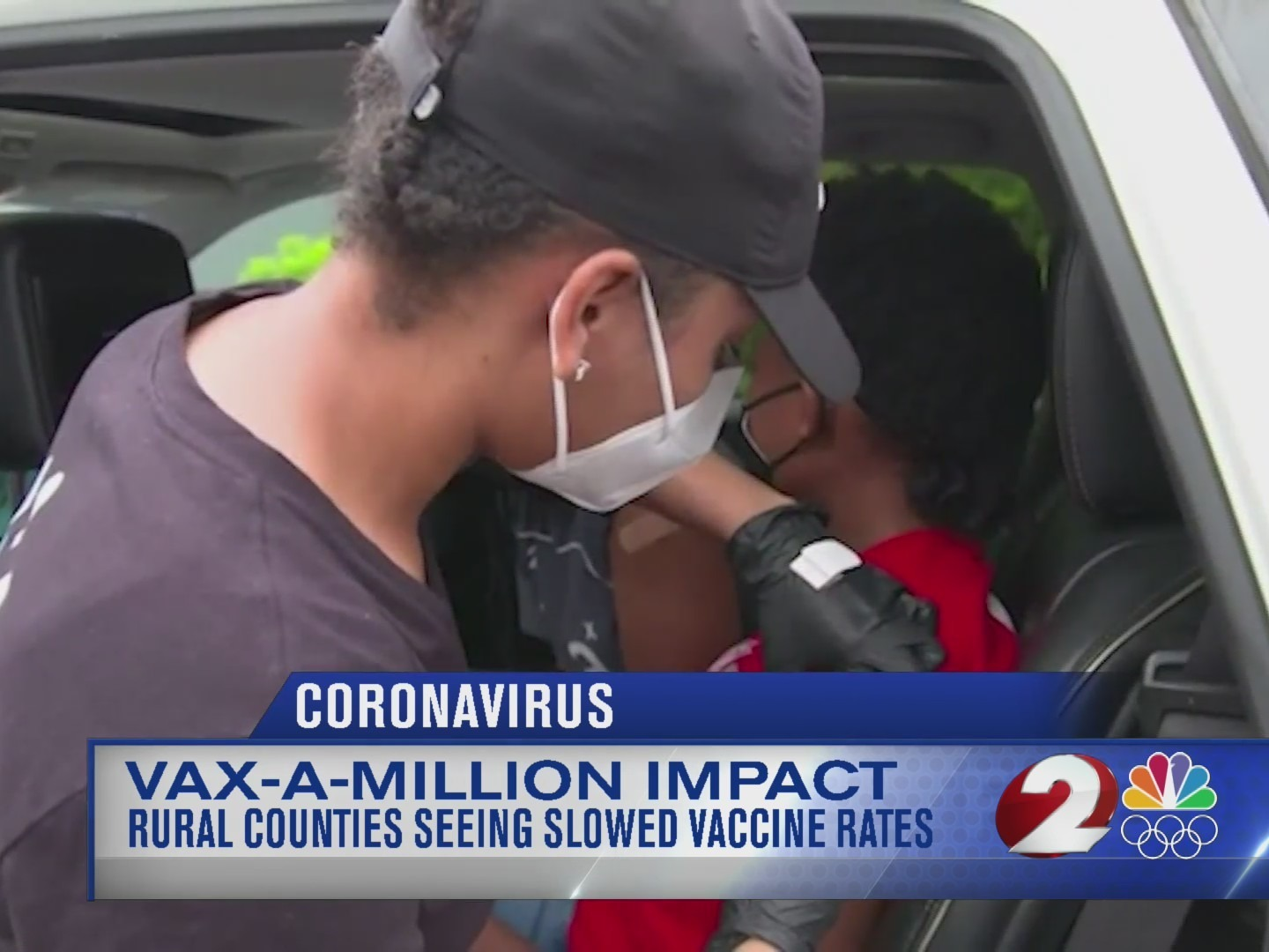 Health official administering a vaccine to a child in a car